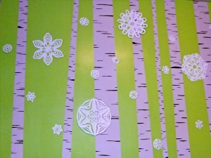 I hung the paper snowflakes on the mural of birch trees on my kitchen wall. I like them more than the beautiful matched-set glass ornaments I bought last year. Not bad for a few sheets of copy paper.